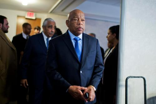 UNITED STATES - FEBRUARY 11: Rep. John Lewis, D-Ga., and Rep. Charlie Rangel, D-N.Y., behind him, arrive for a news conference at the DNC where members of the Congressional Black Caucus PAC endorsed Hillary Clinton for president, February 11, 2016. (Photo By Tom Williams/CQ Roll Call)